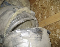 Attic duct that is broken allowing cool air and warm air to enter the attic instead of the living area of the home.